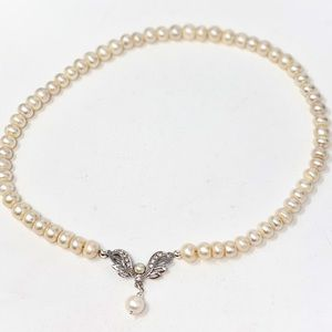 Freshwater pearl necklace - Swarovski wings clasp